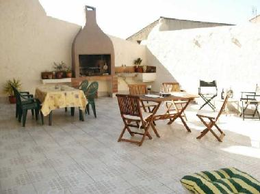 Communal sun terrace with bbq, lots of seating and 2 sunbeds