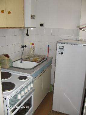 Kitchen with 4 ring stove and fridge
