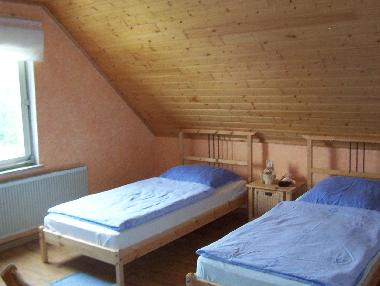 double bedroom with individual beds and cod