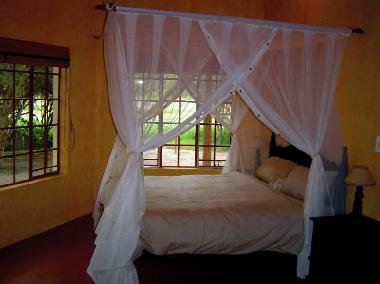 Bed with net in bedroom 2