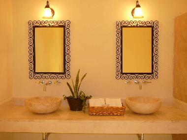 bathrooms have double sinks and toptable from macedonia made by local craftsman like the iron wrough