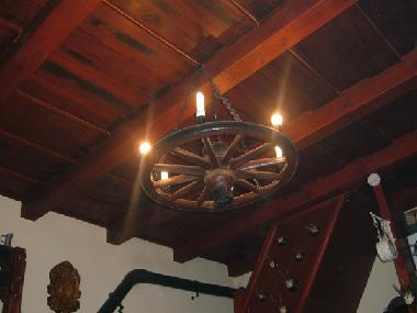 Wooden beamed ceiling with cartwheel light fitting