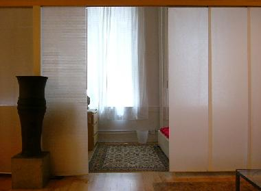 apt 1 view to sleeping area with dividers open