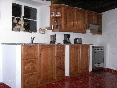 The kitchen is hand made of local wood with full stove, fridge/freezer kettle, toaster ,microwave, a