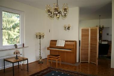 There is a well maintained IBACH piano