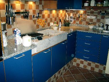 Other side of kitchen, marble sink, granite surfaces