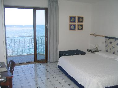 double twin beds room balcony sea view