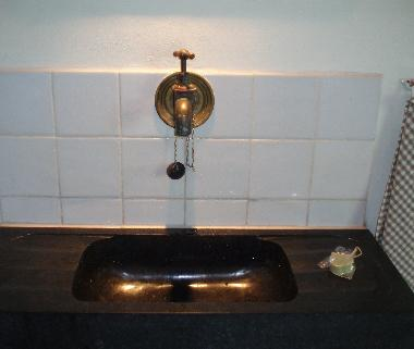 Sink of Belgian stone with old cold tab