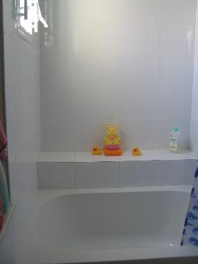 Little bathtub in the bathroom. Great for kids!