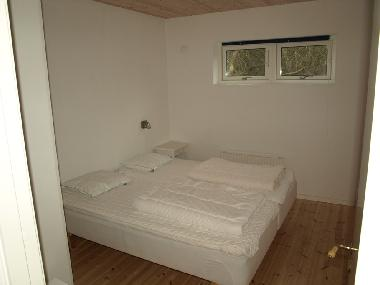 One of the four Bedrooms with high quality beds