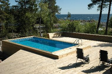 Private, heated pool with a big terrass with an beautiful sea view