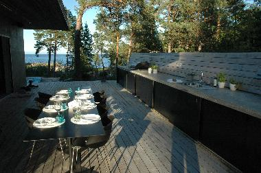 Terracce (30 m2) by the main house. Make your food looking out on the sea at the outdoor kitchen