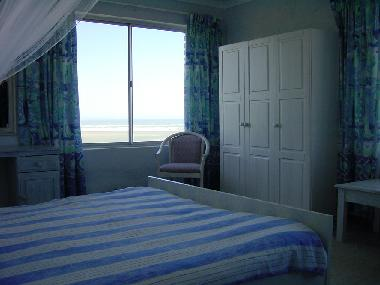 Main Bedroom with window looking out to sea