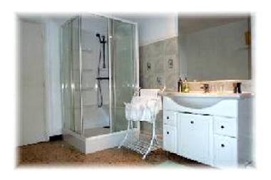 Large pristine clean bathroom with shower seat