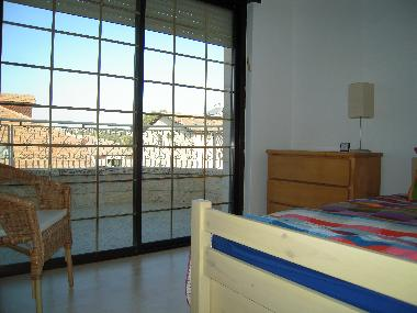 2nd bedroom has a trundle bed, room sleeps 2 guests.  The washing machine is located on this balcony