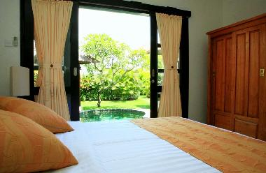 Bedroom overlooking the private Pool