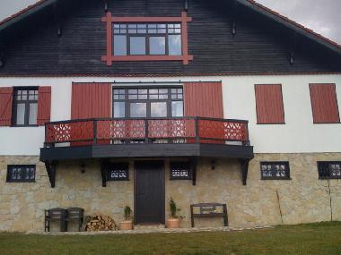 The front of the chalet with balcony