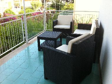 Terrace with garden furniture.