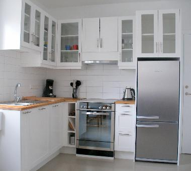 Kitchen with full size fridge and oven/stove