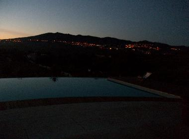 Mountain view at sunset by swimming pool