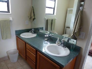 ensuite bathroom with shower and toilet