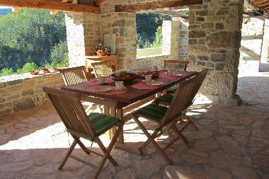 Covered terrace, extendible table for up to 10 persons