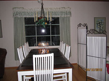 Dining table for 8 persons. The sleeping corner is on the right.