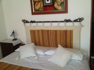 Double bed details wit embroided linen bed. Apartment in Basilicata.
