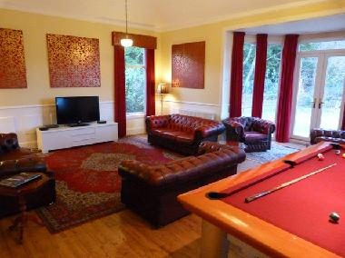 Family Room with seating for all, TV and Pool Table