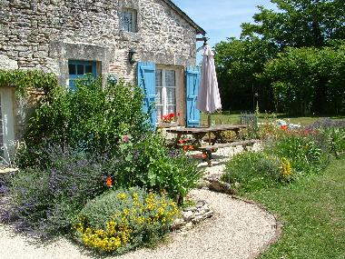 Sunrise Cottage. Flower beds of scented flowers and herbs