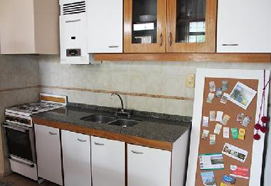 Kitchen with microwave, fridge and freezer, toaster, oven, stove