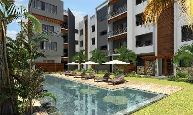 Back side of the complex ground floor apartment with swimming pool view