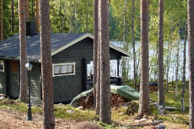 Lakeside sauna has a wood-burning stove and a big terrace.