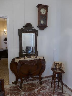 hall with antique furniture of 18th century, bronze ornaments, bronze vases