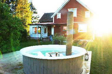 Wooden-heated tub that is possible to rent (55 Euro/rental period + used wood)