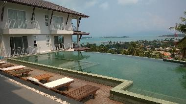 Infinity pool overlooking the sea and offshore islands