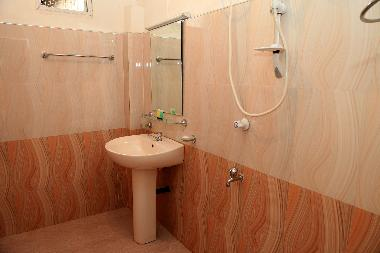 The modern bathroom is clean, fresh and includes many amenities