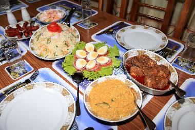 Special fried rice, chicken curry, dhal curry and egg salad by chef Kapila